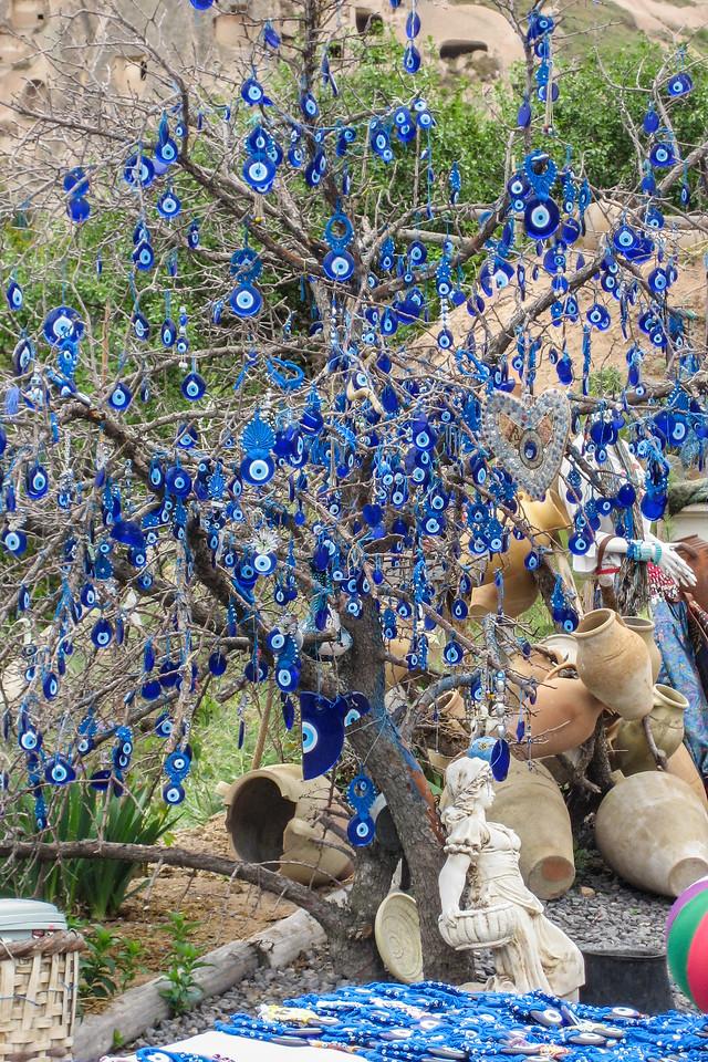 A tree full of Turkish Nazars (evil eye charms)