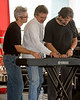 The Keith Longbotham Trio tries its 6 hands at playing the piano together on stage at the FMCA Motorhome Conference in Pomona, CA Feb 28, 2008.