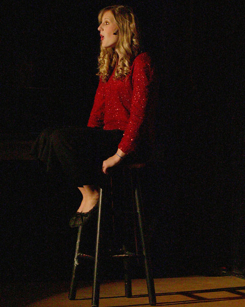 "Hannah Merrill sings at the pre-show to ""Seven Brides for Seven Brothers"" at the Playmill Theatre in West Yellowstone, Summer 2006."