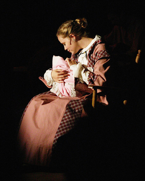 """Andrea Daveline with her """"baby"""" in """"Seven Brides for Seven Brothers"""" performed in the Summer 2006 season at the Playmill Theatre in West Yellowstone, MT."""