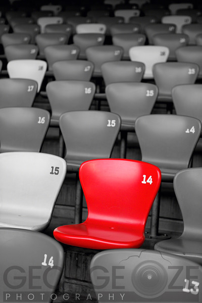 Stadium Seats in Black and White with a Single Red Seat