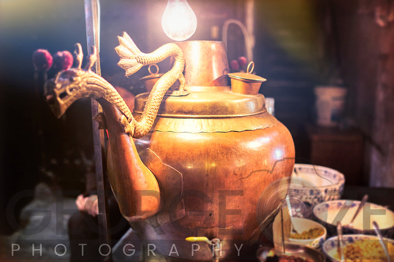 Traditional Chinese Tea Kettle on a Market Stand at Night, Xi'an, Shaanxi, China
