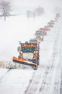 DON'T FOLLOW SO CLOSELY!!!  Notice how closely the vehicle immediately behind the plow is following--you can only see the top of the vehicle and not its headlights.   I-35 Northbound lane looking south from 195th St; Lakeville.