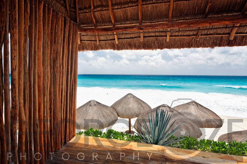 Beach Scene with Palapas, Cancun, Mexico