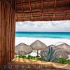 Beach Scene with Palapas, Cancun, Mexico