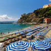 Lounge Chairs and Beach Umbrellas on the Shore, Monterosso Al Mare, Cinque Terre, Liguria, Italy