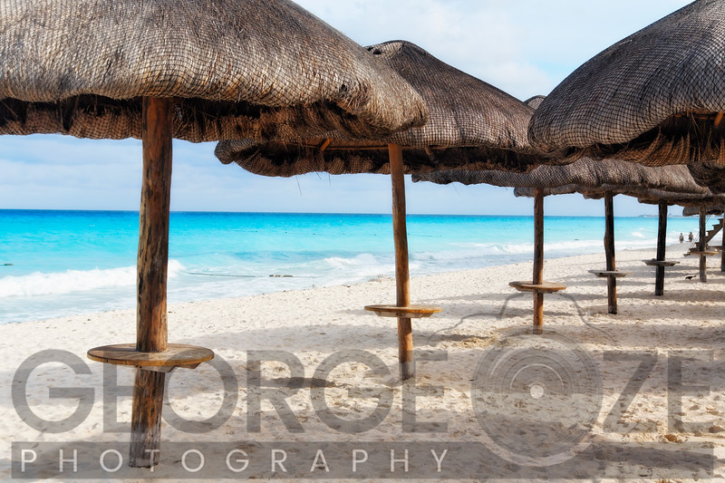 Palapas Lined up on the Beach, Cancun, Mexico