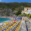Row of Lounge Chairs and Umbrellas on a Beach, Monterosso Al Mare, Cinque Terre, Liguria, Italy