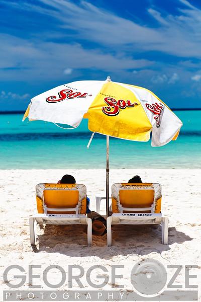 Relaxing Under a Beach Umbrella, Playa Norte, Isla Mujeres, Quintana Roo, Mexico