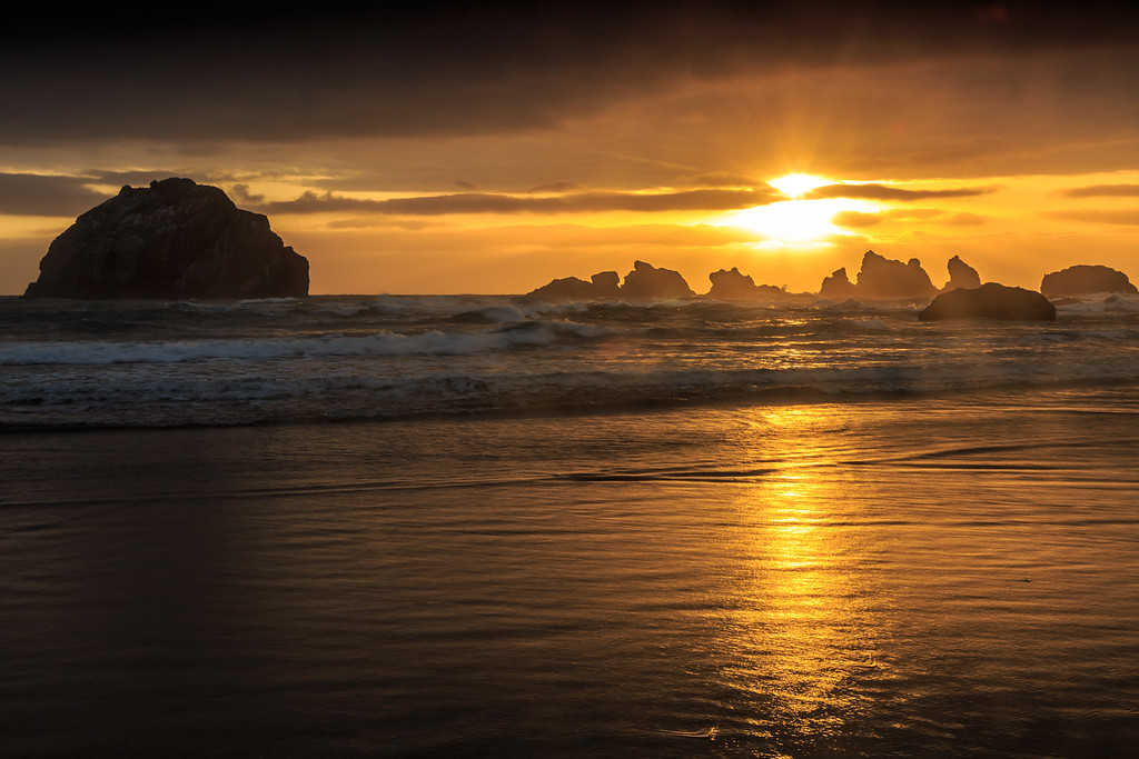 Golden sun over Face Rock at Bandon Oregon