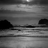 Sun and clouds battle over the beach at Bandon Oregon