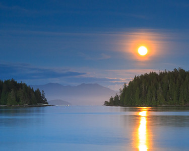 Glowing moon over water