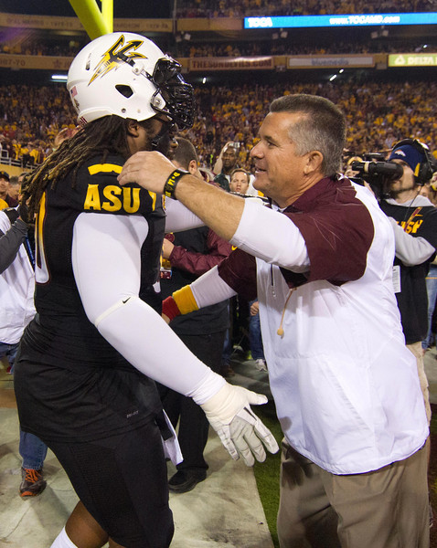Arizona State Sun Devil Head Coach Todd Graham greets Senior Defensive Lineman Will Sutton prior to Arizona State's 58-21victory over Arizona.
