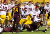 USC's Marqise Lee twists his knee as he is tackled by Arizona State's Davon Coleman during USC's 62-41 loss to Arizona State on Sept. 28.2013. Credit: Buckeye Valley News Photo by Michael Rincon - For Editorial Purposes Only