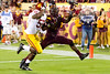 Arizona State's Marion Grice attempts to haul in a pass from quarterback Taylor Kelly as USC's Lamar Dawson defends during ASU's 62-41 victory over the Trojans on Sept 28, 2013.  The pass was incomplete. Credit: Buckeye Valley News Photo by Michael Rincon - For Editorial Purposes Only