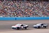 NASCAR drivers Dale Earnhardt, Jr. and Jimmie Johnson circle the track during the Subway Fresh Fit 500 at Phoenix International Raceway on March 3, 2013.