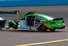 NASCAR driver Danica Patrick's car is towed to the garage following a accident during the Subway Fresh Fit 500 at Phoenix International Raceway on March 3, 2013.  Patrick blew a tire in the fourth turn and collected David Ragan in a two-car wreck.