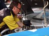 Joe Gibbs' racing engine tuner Kirk Butterfield works on changing the engine in NASCAR driver Kyle Busch's race care prior to the Subway Fresh Fit 500 at Phoenix International Raceway on March 3, 2013.