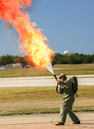 A marine with the Museum of the Pacific War demonstrates a flame thrower.