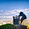 The Grape Crusher Statue agains Dramatic Sky, Napa Valley, California