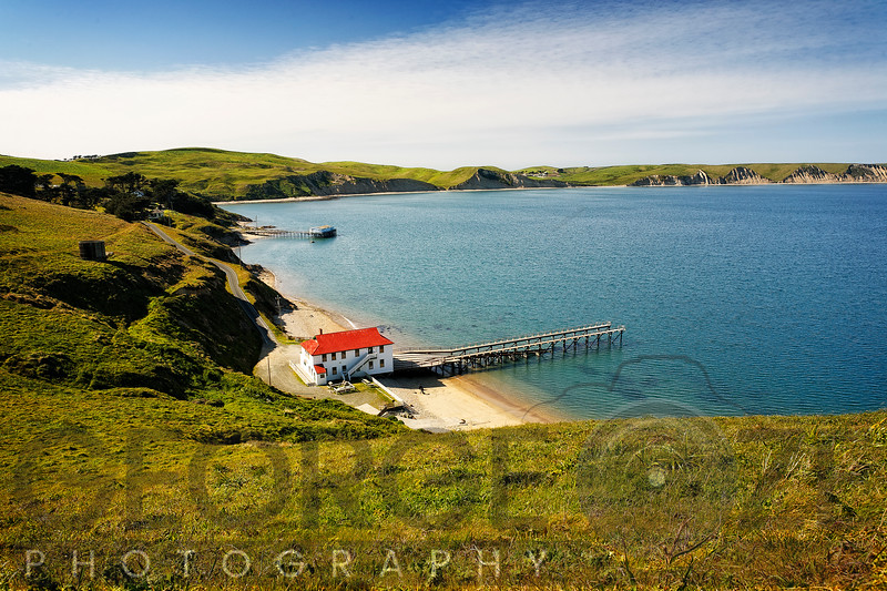High Angle View of Drakes Bay with a Red Roofed Boathouse and Pier, Point Reyes National Seashore, California
