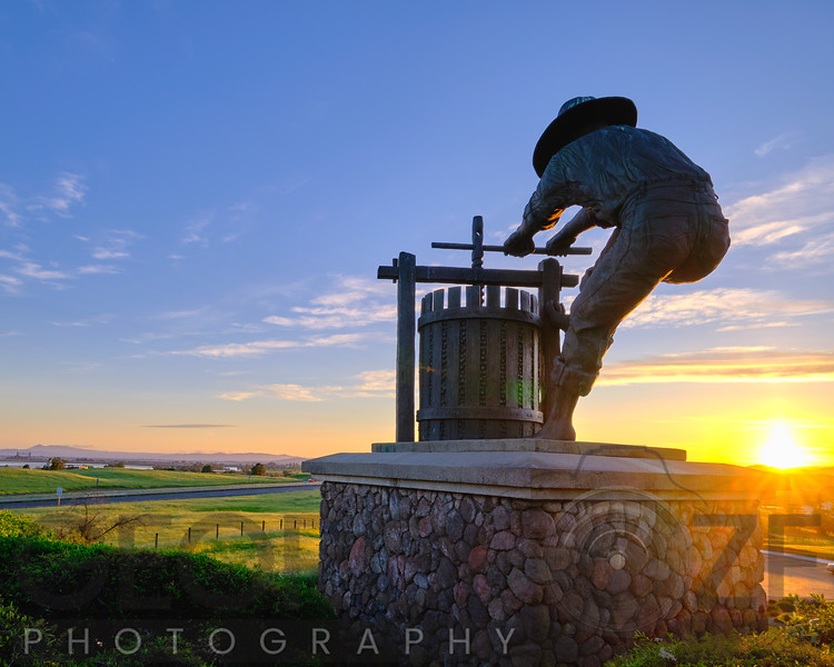 The Grape Crusher Statue at Sunset, Napa Valley, California