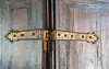 Antique Hinge On Textured Door