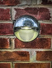 Eye Shaped Light On Brick Wall