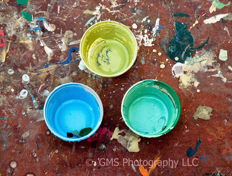 Coating of different colored paint remain in plastic cups used by Artists to create mural at Riverside Gardens Park in Red Bank, New Jersey