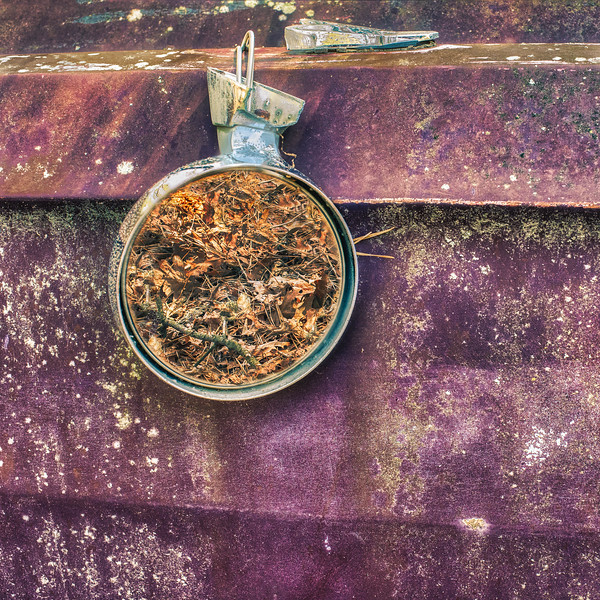 Suspended Mirror On Rusting Automobile