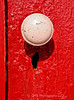 An old doorknob casts shadow over worn keyhole at tent city in Ocean Grove New Jersey.