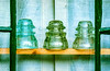 Vintage Glass Electrical Insulators In Window