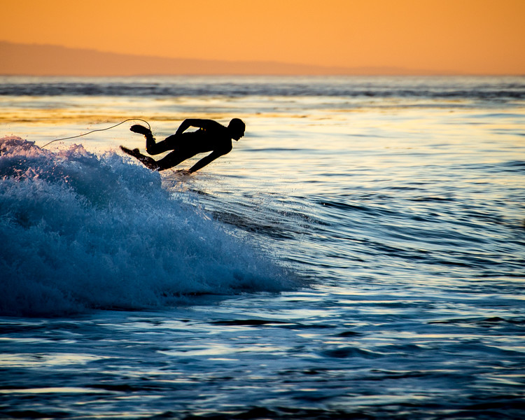 Sunset Surfer in Flight