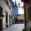 Street View in Zurich Old Town with the St Peter's Church, Switzerland