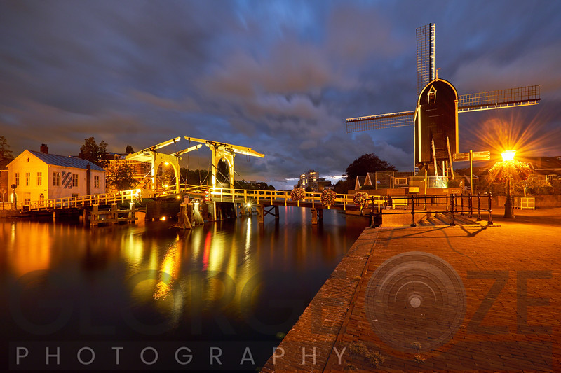 Canal with a Small Bridge and Windmill at Night, Leiden,
