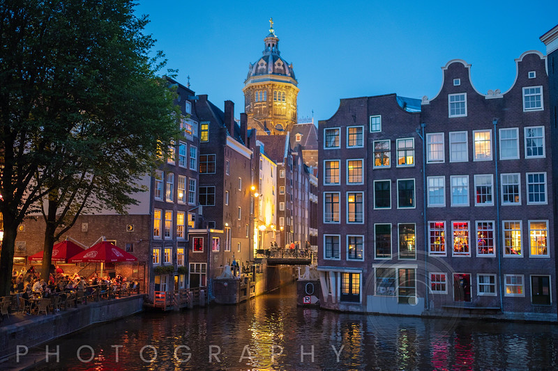 Night Scene in Amsredam with Illuminated Buildings and an Outdoor restaurant, Netherlands