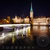 Nighttime View of the Fraumunster Abbey with the Munster Bridge, Zurich, Switzerland