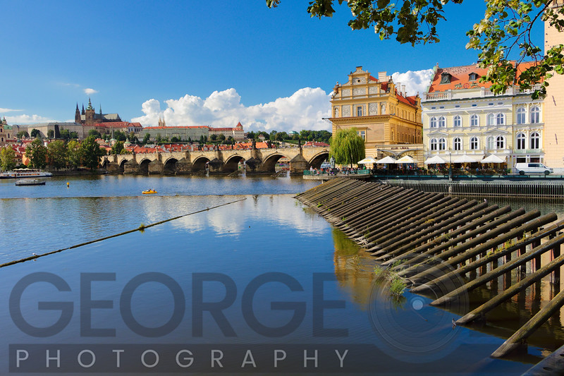 Scenic Old Prague Cityscape with the Charles Bridge and the Castel District