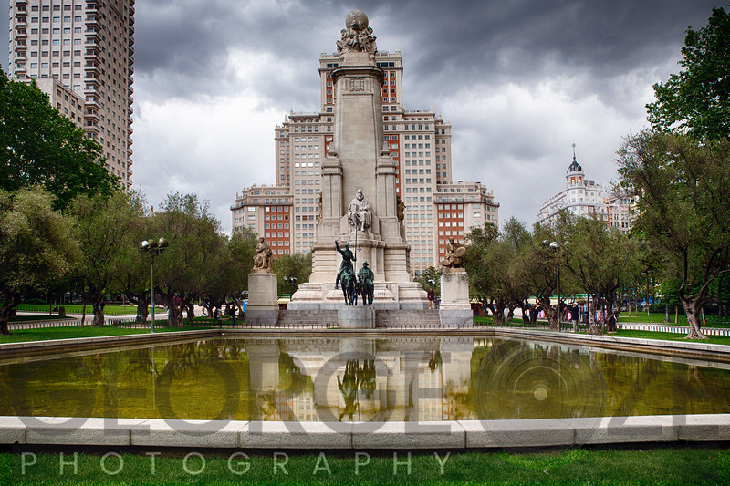 Low Angle View of The Cervantes Monument with a Reflecting Pools, Plaza de Espana, Madrid, Spain