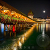 Scenic Night View of the Chapel Bridge in Old Town Lucerne, Switzerland