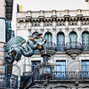 Chinese Dragon Sculpture Attached to the Walls of a House Decorated with Umbrellas,  Bruno Quadras Building, Las Ramblas, Barcelona, Catalonia, Spain