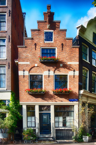Small Gabled Street Corner House in Amsterdam, Netherlkands