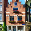 Small Gabled Street Corner House in Amsterdam, Netherlkands