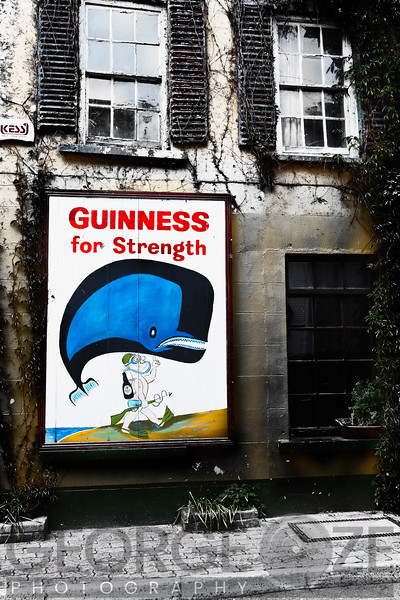 Old Guiness Sign on a House, Kinsale, Coubty Cork, Republic of Ireland