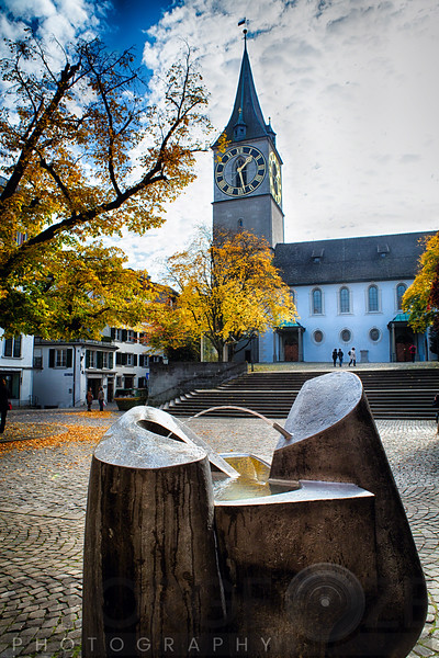 Low Angle View of the Saint Peter's Church, with a Modern Fountain in the Foreground, Zurich, Switzerland