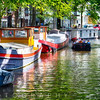 Small Canal with House Barges and a Tour Boat, Amsterdam, Netherlands