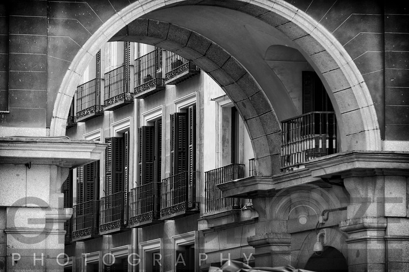 Balconies and Windows with Shutters Viewed through an Arch of a Building, Plaza Mayor, Madrid, Spain