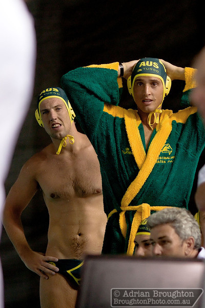 Australia's Trent Franklin and Christian Hoad watch with interest from the Australian bench as the South African coach is ejected from the stadium with only 3.5 seconds left in the men's heat on day 3.
