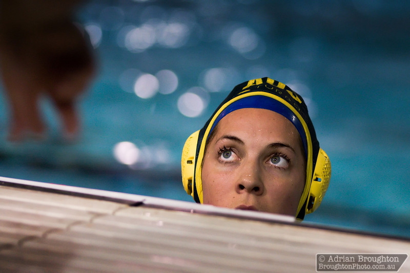 Australia's Jenna Santoromito listens to women's head coach Greg McFadden during a time-out in the heat against South Africa on day 3.