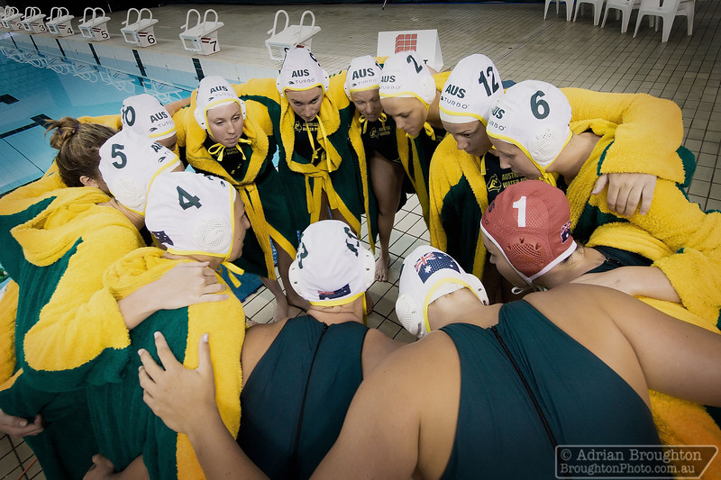 The Australian women's team in a pre-game huddle before their Semi-final game against England on day 7.